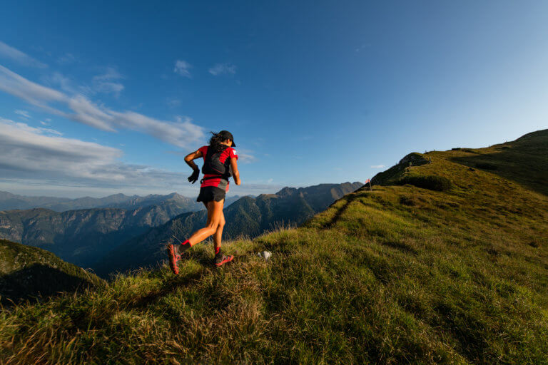 sporty mountain woman rides in trail during endurance trail